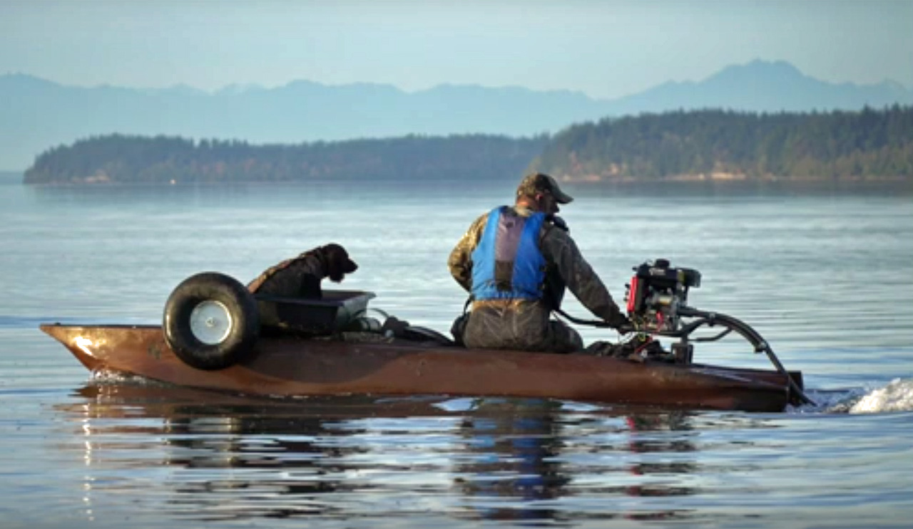 Duck hunter, retrieving dog, and all-terrain all-water hunting boat – kayak.
